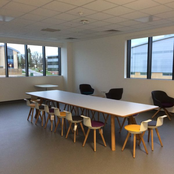 Meeting room table, chairs, floor and internal glass cleaned